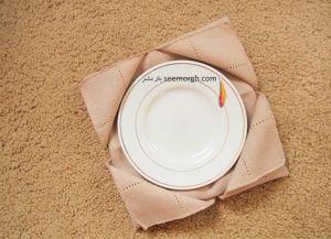 تزیین دستمال سفره میز ناهارخوی به شکل یک زیر بشقابی زیبا